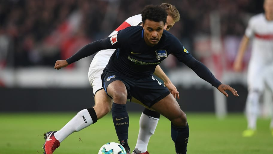 STUTTGART, GERMANY - JANUARY 13: Valentino Lazaro of Berlin (front) fights for the ball with Santiago Ascacibar of Stuttgart during the Bundesliga match between VfB Stuttgart and Hertha BSC at Mercedes-Benz Arena on January 13, 2018 in Stuttgart, Germany. (Photo by Matthias Hangst/Bongarts/Getty Images)