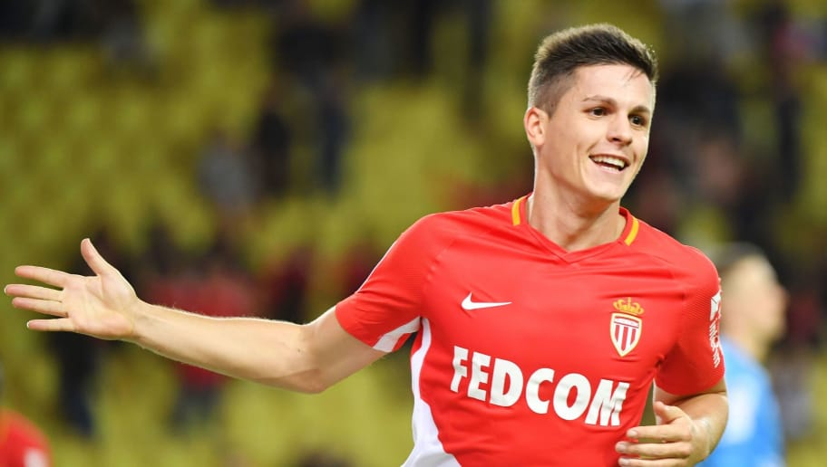 Monaco's Argentinian forward Guido Carrillo celebrates after scoring a goal during the French L1 football match Monaco (ASM) versus Guingamp (EAG) on November 4, 2017 at The Louis II  Stadium in Monaco. / AFP PHOTO / YANN COATSALIOU        (Photo credit should read YANN COATSALIOU/AFP/Getty Images)