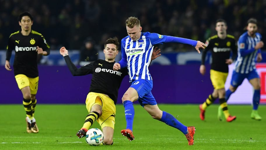 Dortmund's German midfielder Julian Weigl (L) and Berlin's Slovakian midfielder Ondrej Duda  vie for the ball during the German first division Bundesliga football match Hertha BSC Berlin vs BVB Borussia Dortmund, in Berlin, western Germany, on January 19, 2018. / AFP PHOTO / Tobias SCHWARZ / RESTRICTIONS: DURING MATCH TIME: DFL RULES TO LIMIT THE ONLINE USAGE TO 15 PICTURES PER MATCH AND FORBID IMAGE SEQUENCES TO SIMULATE VIDEO. == RESTRICTED TO EDITORIAL USE == FOR FURTHER QUERIES PLEASE CONTACT DFL DIRECTLY AT + 49 69 650050         (Photo credit should read TOBIAS SCHWARZ/AFP/Getty Images)
