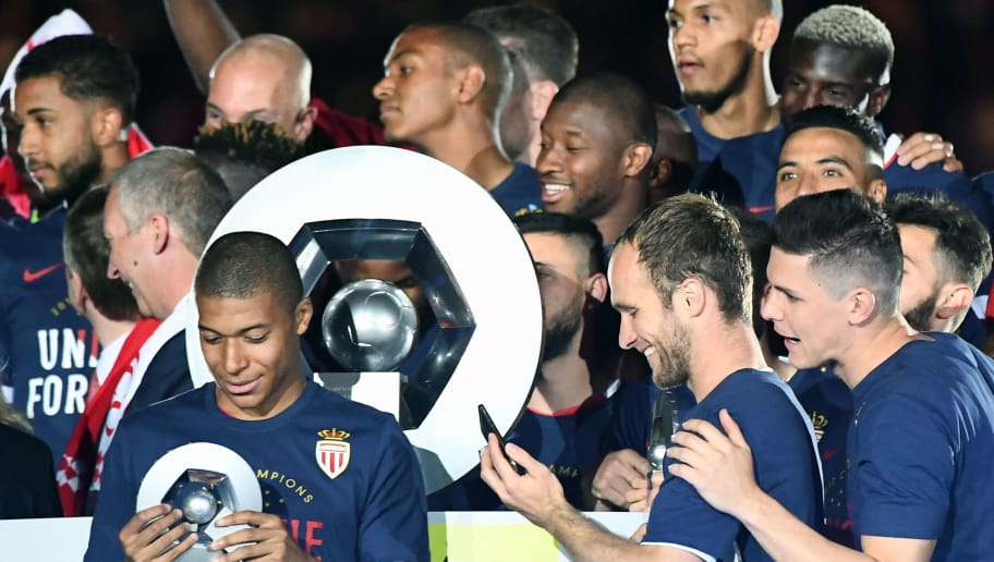 Monaco's French forward Kylian Mbappe Lottin (L) celebrates at the end of their last French L1 football match Monaco (ASM) vs St Etienne (ASSE)  on May 17, 2017 at the 'Louis II Stadium' in Monaco. Monaco on May 17 won their first French league title in 17 years.  / AFP PHOTO / BORIS HORVAT        (Photo credit should read BORIS HORVAT/AFP/Getty Images)