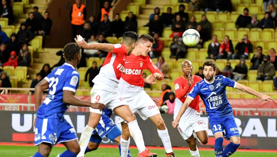 Monaco's Argentinian forward Guido Carrillo (C) heads the ball and scores during the french L1 football match Monaco (ASM) vs Troyes at The Louis II Stadium in Monaco on December 9, 2017. / AFP PHOTO / YANN COATSALIOU        (Photo credit should read YANN COATSALIOU/AFP/Getty Images)