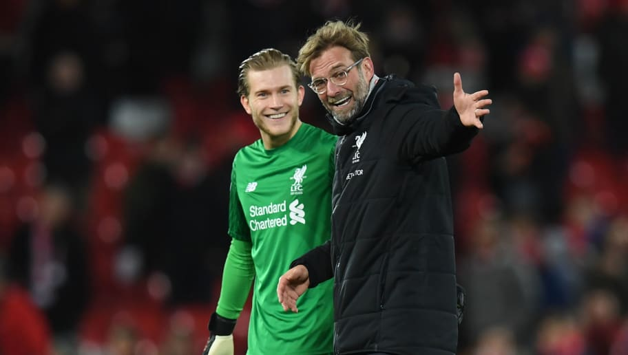 Liverpool's German manager Jurgen Klopp (R) congratulates Liverpool's German goalkeeper Loris Karius after the English Premier League football match between Liverpool and Leicester at Anfield in Liverpool, north west England on December 30, 2017. / AFP PHOTO / Paul ELLIS / RESTRICTED TO EDITORIAL USE. No use with unauthorized audio, video, data, fixture lists, club/league logos or 'live' services. Online in-match use limited to 75 images, no video emulation. No use in betting, games or single club/league/player publications.  /         (Photo credit should read PAUL ELLIS/AFP/Getty Images)