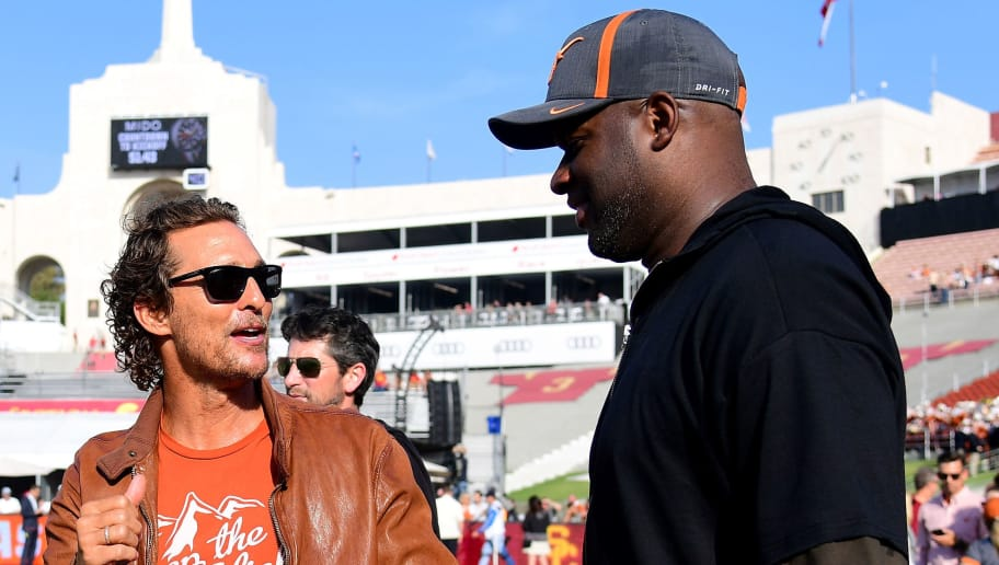 LOS ANGELES, CA - SEPTEMBER 16:  Actor Matthew McConaughey and quarterback Vince Young talk on the sidelines before the game between the Texas Longhorns and the USC Trojans at Los Angeles Memorial Coliseum on September 16, 2017 in Los Angeles, California.  (Photo by Harry How/Getty Images)