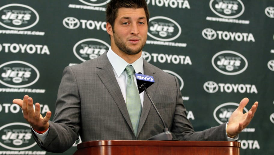 FLORHAM PARK, NJ - MARCH 26:  Quarterback Tim Tebow addresses the media as he is introduced as a New York Jet at the Atlantic Health Jets Training Center on March 26, 2012 in Florham Park, New Jersey. Tebow, traded from the Denver Broncos last week, will be the team's backup quarterback according to Jets head coach Rex Ryan. Tebow, the 2007 Heisman Trophy winner, started 11 games in 2011 for Denver and finished with a 7-4 record as a starter. He led the Broncos to a playoff overtime win against the Pittsburgh Steelers in the first round before eventually losing to the New England Patriots in the next round.  (Photo by Mike Stobe/Getty Images)