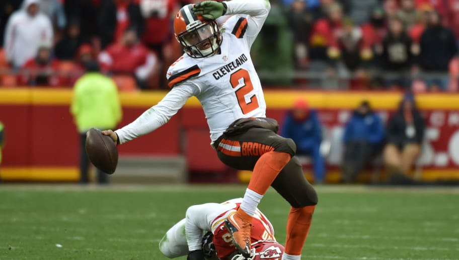 KANSAS CITY, MO - DECEMBER 27: Johnny Manziel #2 of the Cleveland Browns fights his way out of a tackle attempt from Derrick Johnson #56 of the Kansas City Chiefs at Arrowhead Stadium during the fourth quarter of the game on December 27, 2015 in Kansas City, Missouri. (Photo by Peter Aiken/Getty Images)