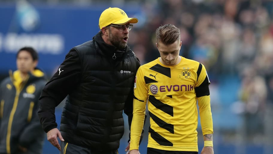 HAMBURG, GERMANY - MARCH 07:  Head coach Juergen Klopp (L-R) and Marco Reus of Dortmund appears frustrated after the First Bundesliga match between Hamburger SV and Borussia Dortmund at Imtech Arena on March 7, 2015 in Hamburg, Germany.  (Photo by Oliver Hardt/Bongarts/Getty Images)