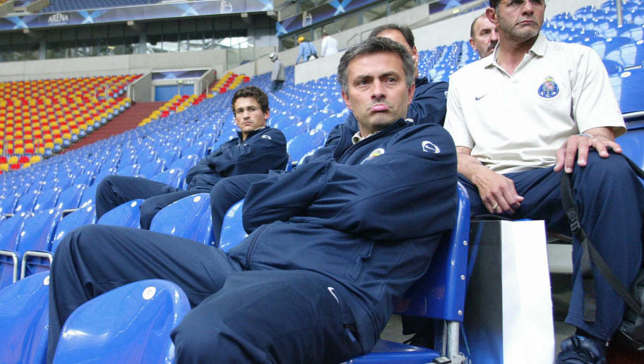 GELSENKIRCHEN, Germany:  FC Porto trainer Jose Mourinho watches AS Monaco's training session, 25 May 2004 in the Arena AufSchalke stadium in the western town of Gelsenkirchen, one day before the Champions' League football final opposing French AS Monaco football team to Portugal's FC Porto.     AFP PHOTO MIGUEL RIOPA  (Photo credit should read MIGUEL RIOPA/AFP/Getty Images)