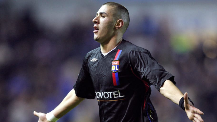 Karim Benzema of Lyon celebrates scoring the third goal during their UEFA Champions League group E football match, 12 December 2007 against Rangers at Ibrox, Glasgow, Scotland. AFP PHOTO/ANDREW YATES (Photo credit should read ANDREW YATES/AFP/Getty Images)