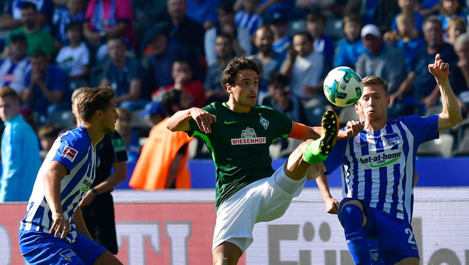 Bremen's Danish midfielder Thomas Delaney (L) and Berlin's German midfielder Mitchell Weiser vie for the ball during the German first division Bundesliga football match between Hertha Berlin and Werder Bremen on September 10, 2017 in Berlin, Germany. / AFP PHOTO / Tobias SCHWARZ / RESTRICTIONS: DURING MATCH TIME: DFL RULES TO LIMIT THE ONLINE USAGE TO 15 PICTURES PER MATCH AND FORBID IMAGE SEQUENCES TO SIMULATE VIDEO. == RESTRICTED TO EDITORIAL USE == FOR FURTHER QUERIES PLEASE CONTACT DFL DIRECTLY AT + 49 69 650050         (Photo credit should read TOBIAS SCHWARZ/AFP/Getty Images)