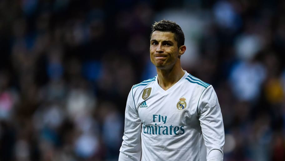 Real Madrid's Portuguese forward Cristiano Ronaldo reacts during the Spanish league football match between Real Madrid CF and RC Deportivo de la Coruna at the Santiago Bernabeu stadium in Madrid on January 21, 2018. / AFP PHOTO / OSCAR DEL POZO        (Photo credit should read OSCAR DEL POZO/AFP/Getty Images)