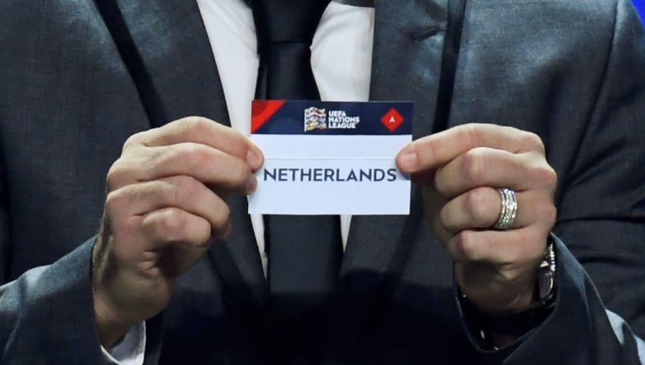 Portuguese former football player Deco shows the name of Netherlands during the UEFA Nations League draw at the headquarters of the European football organisation in Lausanne, on January 24, 2018. / AFP PHOTO / Philippe DESMAZES        (Photo credit should read PHILIPPE DESMAZES/AFP/Getty Images)