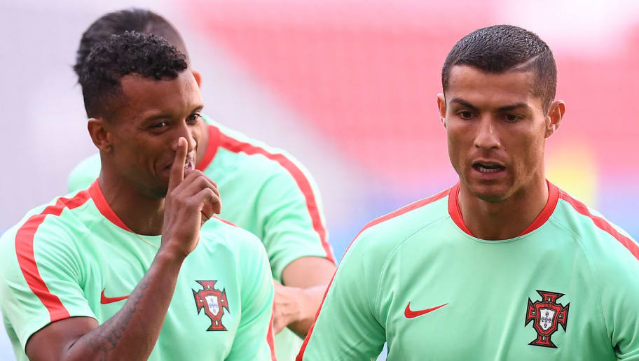 Portugal's forward Cristiano Ronaldo (R) reacts next to forward Nani during a training session at the Kazan Arena stadium in Kazan, Russia, on June 17, 2017 on the eve of the Russia 2017 Confederations Cup football match Portugal vs Mexico. / AFP PHOTO / FRANCK FIFE        (Photo credit should read FRANCK FIFE/AFP/Getty Images)