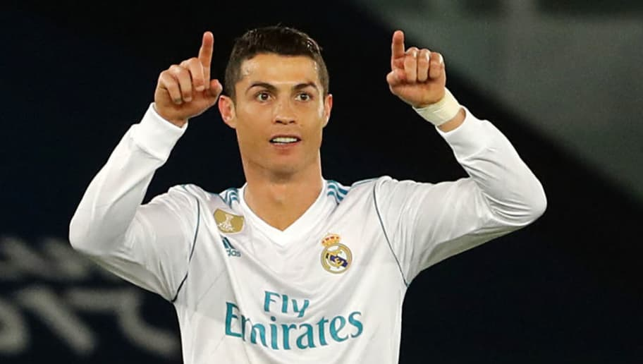 Real Madrid's attacker Cristiano Ronaldo gestures to his teammates during the Club World Cup UAE 2017 final football match between Gremio FBPA and Real Madrid at the Zayed Sports City Stadium in Abu Dhabi on December 16, 2017. / AFP PHOTO / KARIM SAHIB        (Photo credit should read KARIM SAHIB/AFP/Getty Images)