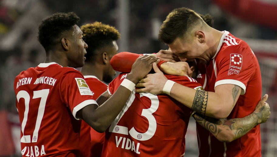 Bayern Munich's players celebrate after their fourth goal during the German first division Bundesliga football match, Bayern Munich v TSG 1899 Hoffenheim, on January 27, 2018 in Munich, southern Germany. / AFP PHOTO / Gunter SCHIFFMANN / RESTRICTIONS: DURING MATCH TIME: DFL RULES TO LIMIT THE ONLINE USAGE TO 15 PICTURES PER MATCH AND FORBID IMAGE SEQUENCES TO SIMULATE VIDEO. == RESTRICTED TO EDITORIAL USE == FOR FURTHER QUERIES PLEASE CONTACT DFL DIRECTLY AT + 49 69 650050         (Photo credit should read GUNTER SCHIFFMANN/AFP/Getty Images)