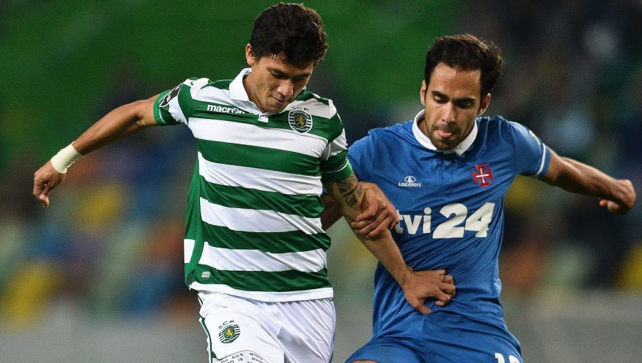 Sporting's Colombian forward Fredy Montero (L) vies with Belenenses's midfielder Ricardo Dias during the Portuguese league football match Sporting CP vs Os Belenses at the Jose Alvalade stadium in Lisbon on November 30, 2015.  AFP PHOTO/ PATRICIA DE MELO MOREIRA / AFP / PATRICIA DE MELO MOREIRA        (Photo credit should read PATRICIA DE MELO MOREIRA/AFP/Getty Images)
