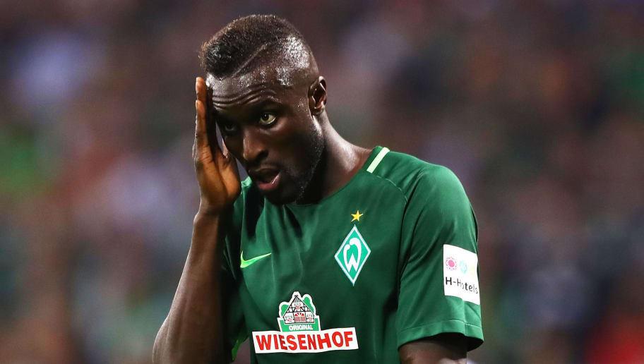 BREMEN, GERMANY - OCTOBER 15:  Lamine Sane of Werder Bremen is dejected during the Bundesliga match between SV Werder Bremen and Borussia Moenchengladbach at Weserstadion on October 15, 2017 in Bremen, Germany.  (Photo by Martin Rose/Bongarts/Getty Images)