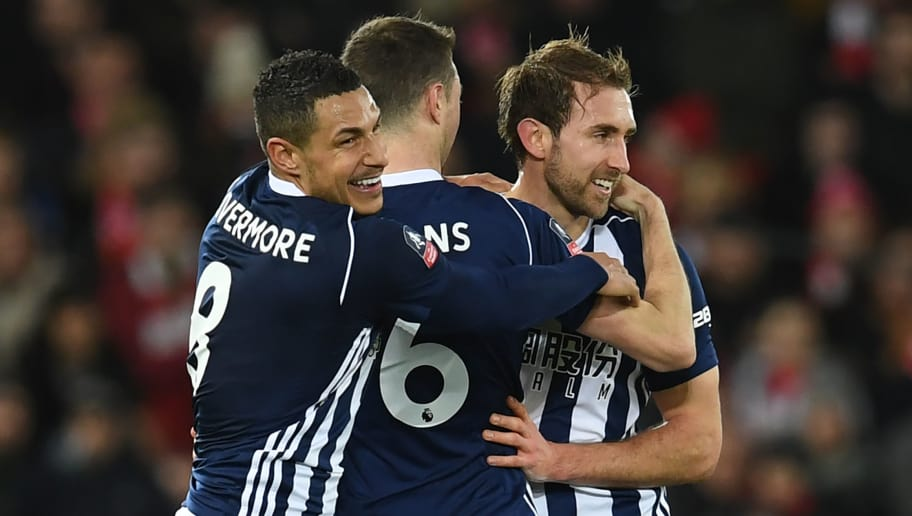 West Bromwich Albion's English defender Craig Dawson (R), West Bromwich Albion's Northern Irish defender Jonny Evans (C) and West Bromwich Albion's English midfielder Jake Livermore (L) celebrates their (confirmed by VAR (Video Assistant Referee) third goal during the English FA Cup fourth round football match between Liverpool and West Bromwich Albion at Anfield in Liverpool, north west England on January 27, 2018. / AFP PHOTO / Paul ELLIS / RESTRICTED TO EDITORIAL USE. No use with unauthorized audio, video, data, fixture lists, club/league logos or 'live' services. Online in-match use limited to 75 images, no video emulation. No use in betting, games or single club/league/player publications.  /         (Photo credit should read PAUL ELLIS/AFP/Getty Images)