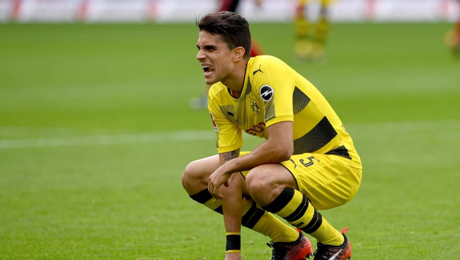 FREIBURG GERMANY - SEPTEMBER 9: Marc Aregall Bartra of Borussia Dortmund reacts after getting injured during the Bundesliga match between Sport Club Freiburg and Borussia Dortmund at Schwarzwald-Stadion on September 9, 2017 in Freiburg, Germany.  (Photo by Michael Kienzler/Bongarts/Getty Images)