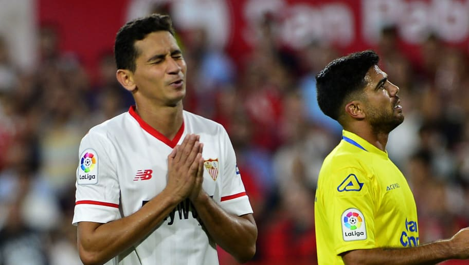 Sevilla's Brazilian midfielder Ganso (L) gestures beside Las Palmas' defender Aythami Artiles during the Spanish league football match Sevilla FC against UD Las Palmas at the Ramon Sanchez Pizjuan stadium in Sevilla on September 20, 2017. / AFP PHOTO / CRISTINA QUICLER        (Photo credit should read CRISTINA QUICLER/AFP/Getty Images)