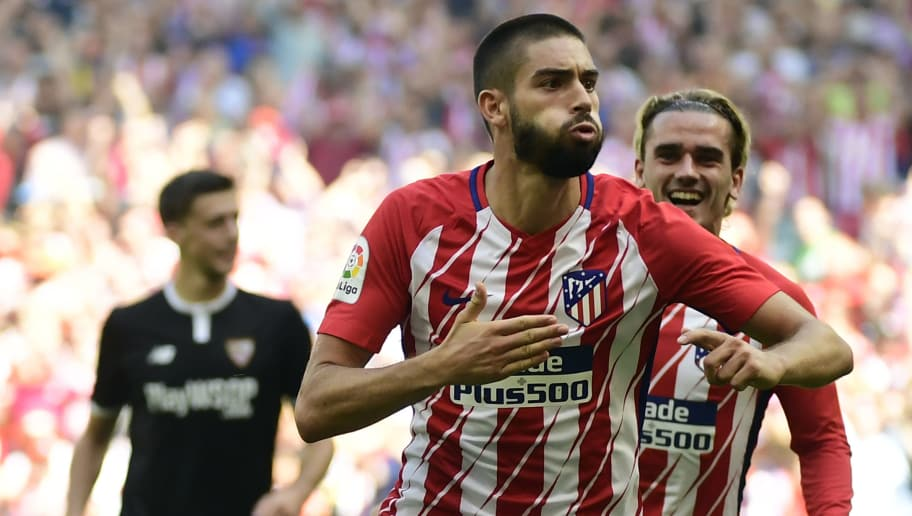 Atletico Madrid's midfielder from Belgium Yannick Ferreira-Carrasco (C)  celebrates a goal beside Atletico Madrid's forward from France Antoine Griezmann (R) during the Spanish league football match Club Atletico de Madrid vs Sevilla FC at the Wanda Metropolitano stadium in Madrid on September 23, 2017. / AFP PHOTO / PIERRE-PHILIPPE MARCOU        (Photo credit should read PIERRE-PHILIPPE MARCOU/AFP/Getty Images)