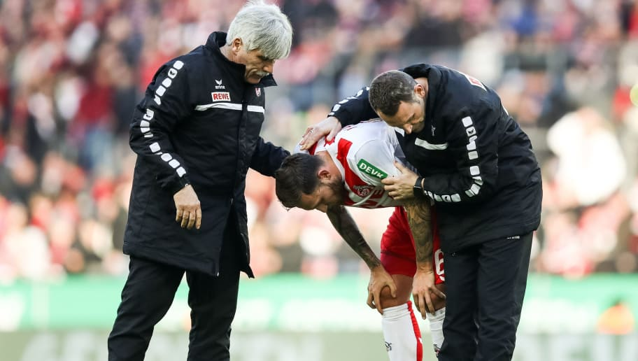 COLOGNE, GERMANY - JANUARY 27: Marco Hoger #6 of 1.FC Koeln receives a medical treatment during the Bundesliga match between 1. FC Koeln and FC Augsburg at RheinEnergieStadion on January 27, 2018 in Cologne, Germany. (Photo by Maja Hitij/Bongarts/Getty Images)