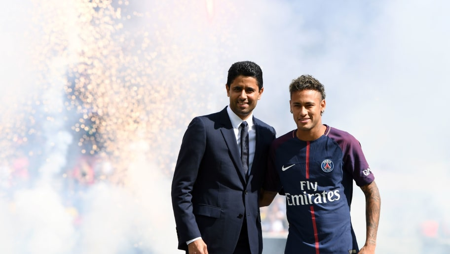 Paris Saint-Germain's Brazilian forward Neymar (R) poses with Paris Saint Germain's (PSG) Qatari president Nasser Al-Khelaifi (L) during his presentation to the fans at the Parc des Princes stadium in Paris, on August 5, 2017. Brazil superstar Neymar will watch from the stands as Paris Saint-Germain open their season on August 5, 2017, but the French club have already clawed back around a million euros on their world record investment. Neymar, who signed from Barcelona for a mind-boggling 222 million euros ($264 million), is presented to the PSG support prior to his new team's first game of the Ligue 1 campaign against promoted Amiens.  / AFP PHOTO / ALAIN JOCARD        (Photo credit should read ALAIN JOCARD/AFP/Getty Images)