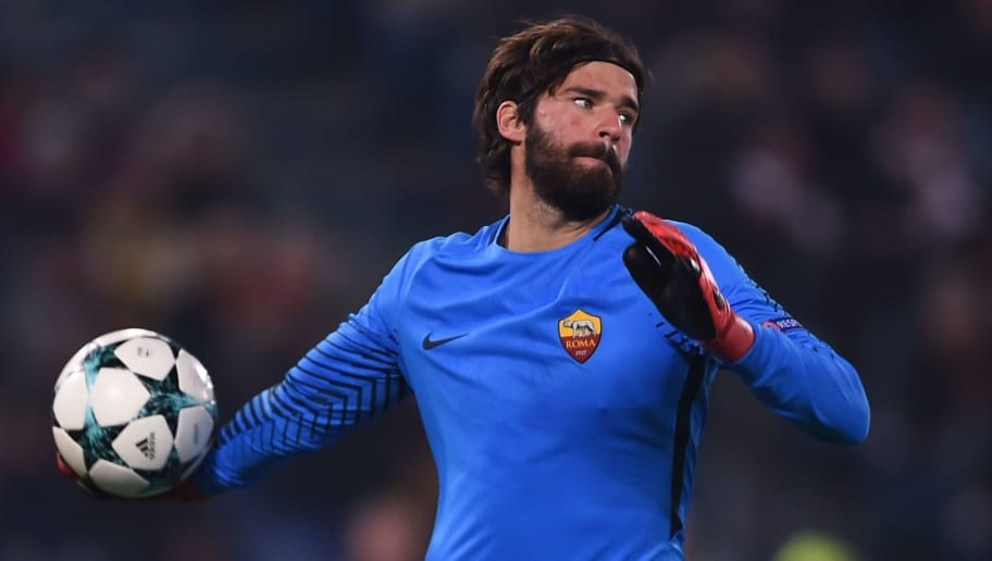 Roma's Brazilian goalkeeper Alisson throws the ball during the UEFA Champions League Group C football match AS Roma vs FK Qarabag on December 5, 2017 at the Olympic stadium in Rome.  / AFP PHOTO / Filippo MONTEFORTE        (Photo credit should read FILIPPO MONTEFORTE/AFP/Getty Images)