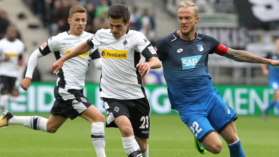 Hoffenheim's German midfielder Kevin Vogt and Moenchengladbach's German midfielder Jonas Hofmann (L) vie for the ball during the German First division Bundesliga football match TSG 1899 Hoffenheim vs Borussia Moenchengladbach in Sinsheim, southwestern Germany, on October 28, 2017. / AFP PHOTO / Daniel ROLAND / RESTRICTIONS: DURING MATCH TIME: DFL RULES TO LIMIT THE ONLINE USAGE TO 15 PICTURES PER MATCH AND FORBID IMAGE SEQUENCES TO SIMULATE VIDEO. == RESTRICTED TO EDITORIAL USE == FOR FURTHER QUERIES PLEASE CONTACT DFL DIRECTLY AT + 49 69 650050         (Photo credit should read DANIEL ROLAND/AFP/Getty Images)
