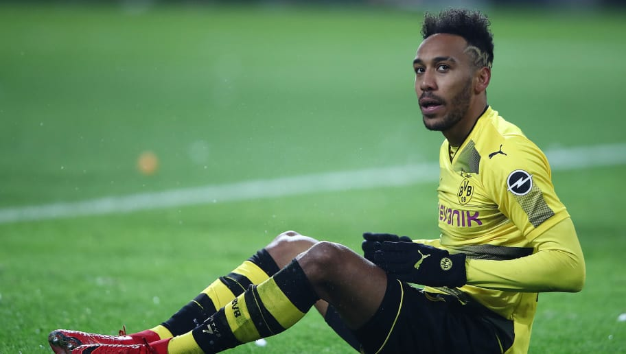 DORTMUND, GERMANY - NOVEMBER 25: Pierre-Emerick Aubameyang of Dortmund sits on the pitch during the Bundesliga match between Borussia Dortmund and FC Schalke 04 at Signal Iduna Park on November 25, 2017 in Dortmund, Germany. (Photo by Alex Grimm/Bongarts/Getty Images)