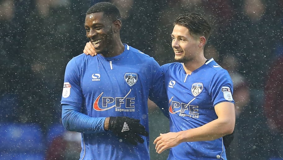 OLDHAM, ENGLAND - DECEMBER 09:  Tope Obadeyi of Oldham Athletic celebrates with team mate Rob Hunt after scoring his sides second goal during the Sky Bet League One match between Oldham Athletic and Northampton Town at Boundary Park on December 9, 2017 in Oldham, England. (Photo by Pete Norton/Getty Images)