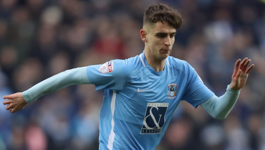 MILTON KEYNES, ENGLAND - JANUARY 27:  Tom Bayliss of Coventry City runs with the ball during The Emirates FA Cup Fourth Round match between Milton Keynes Dons and Coventry City at Stadium mk on January 27, 2018 in Milton Keynes, England.  (Photo by Linnea Rheborg/Getty Images)