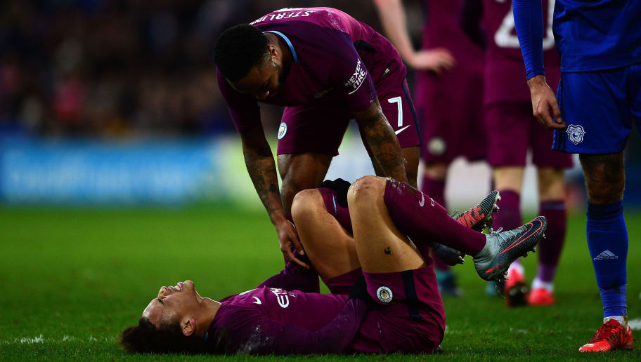 CARDIFF, WALES - JANUARY 28: Leroy Sane of Manchester City lies on the floor in pain after a tackle during The Emirates FA Cup Fourth Round match between Cardiff City and Manchester City at the Cardiff City Stadium on January 28, 2018 in Cardiff, United Kingdom. (Photo by Harry Trump/Getty Images)