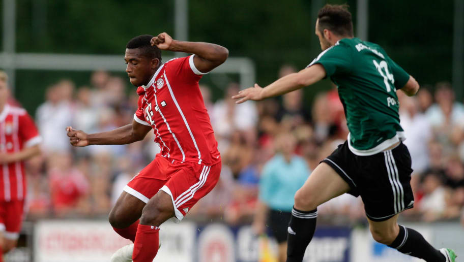 WOLFRATSHAUSEN, GERMANY - JULY 06:  Marco Hingerl (R) of Wolfratshausen and Franck Evina of Bayern fight for the ball during the preseason friendly match between BCF Wolfratshausen and Bayern Muenchen at  on July 6, 2017 in Wolfratshausen, Germany.  (Photo by Johannes Simon/Bongarts/Getty Images)