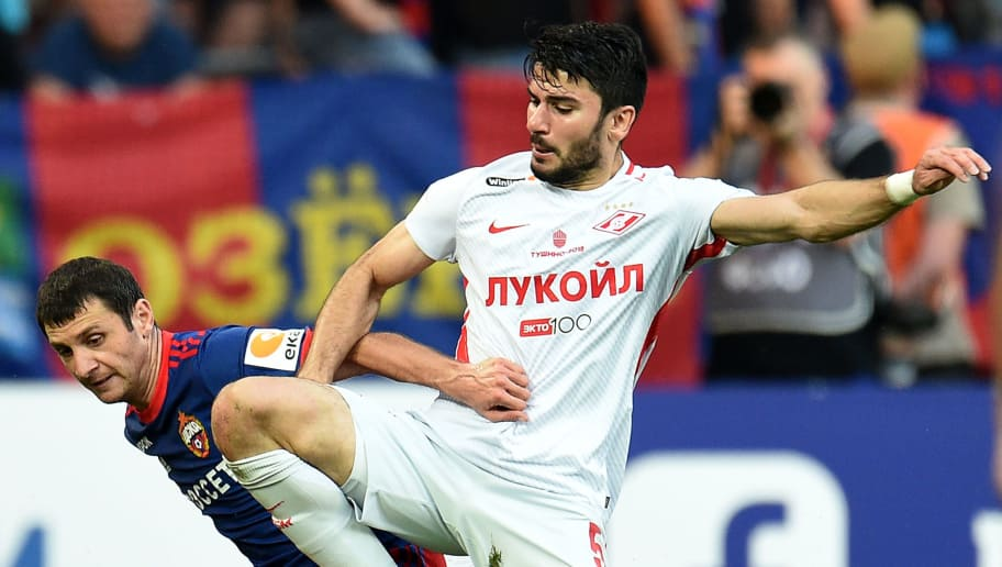 MOSCOW, RUSSIA - AUGUST 12: Alan Dzagoev (L) of PFC CSKA Moscow is challenged by Serdar Tasci of FC Spartak Moscow during the Russian Premier League match between PFC CSKA Moscow and FC Spartak Moscow at the VEB Arena Stadium on August 12, 2017 in Moscow, Russia. (Photo by Epsilon/Getty Images)