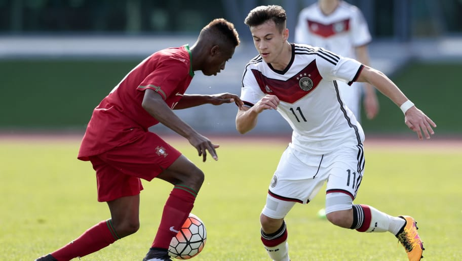VILA REAL DE SANTO ANTONIO, PORTUGAL -  FEBRUARY 4: Umaro Embalo of Portugal challenges Nicolas-Gerrit Kuhn of Germany during the UEFA Under16 match between U16 Portugal v U16 Germany on February 4, 2016 in Vila Real de Santo Antonio, Portugal. (Photo by Filipe Farinha/Bongarts/Getty Images)