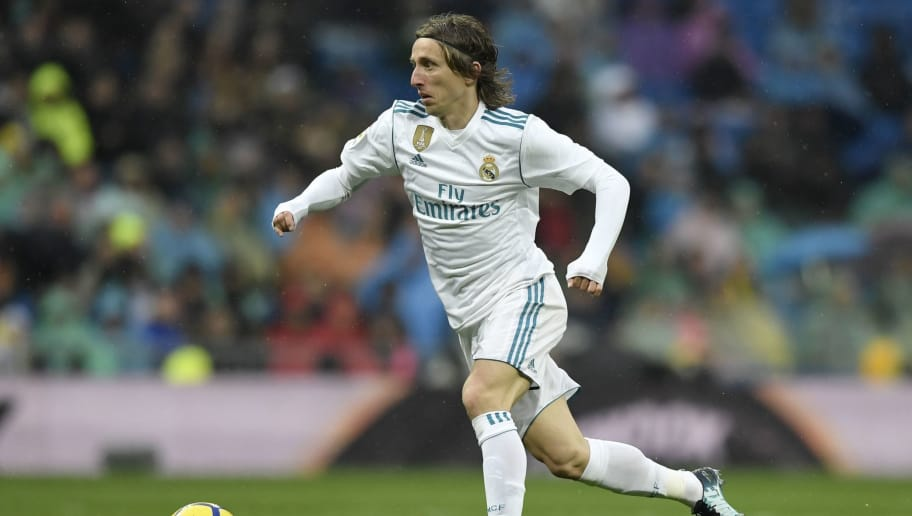 Real Madrid's Croatian midfielder Luka Modric controls the ball during the Spanish league football match between Real Madrid and Villarreal at the Santiago Bernabeu Stadium in Madrid on January 13, 2018. / AFP PHOTO / GABRIEL BOUYS        (Photo credit should read GABRIEL BOUYS/AFP/Getty Images)