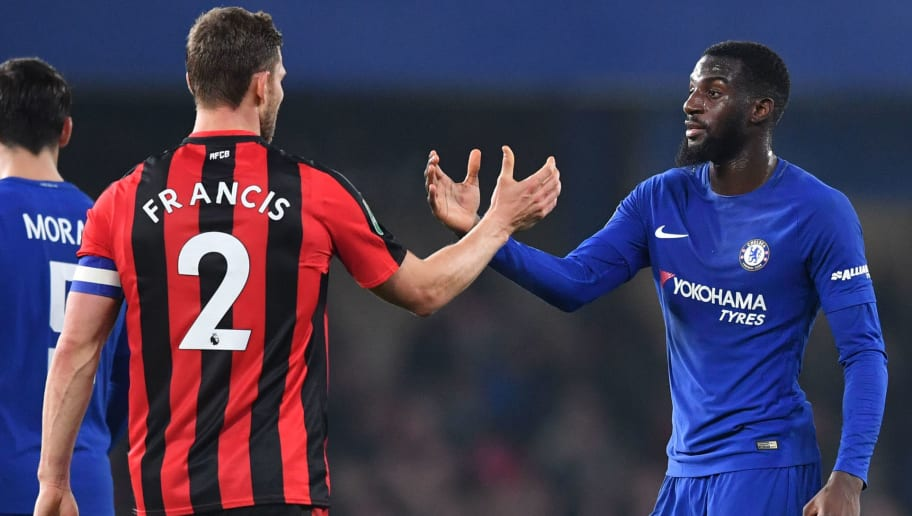 Bournemouth's English defender Simon Francis (L) and Chelsea's French midfielder Tiemoue Bakayoko shake after the English League Cup quarter-final football match between Chelsea and Bournemouth at Stamford Bridge Stadium, in southwest London on December 20, 2017. / AFP PHOTO / Ben STANSALL / RESTRICTED TO EDITORIAL USE. No use with unauthorized audio, video, data, fixture lists, club/league logos or 'live' services. Online in-match use limited to 75 images, no video emulation. No use in betting, games or single club/league/player publications.  /         (Photo credit should read BEN STANSALL/AFP/Getty Images)
