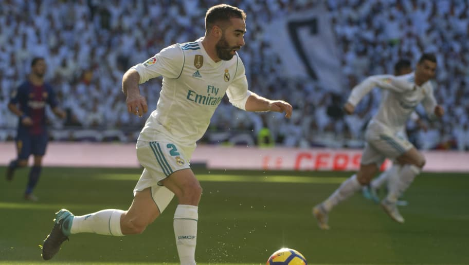 Real Madrid's Spanish defender Dani Carvajal runs with the ball during the Spanish League 'Clasico' football match Real Madrid CF vs FC Barcelona at the Santiago Bernabeu stadium in Madrid on December 23, 2017.  / AFP PHOTO / CURTO DE LA TORRE        (Photo credit should read CURTO DE LA TORRE/AFP/Getty Images)