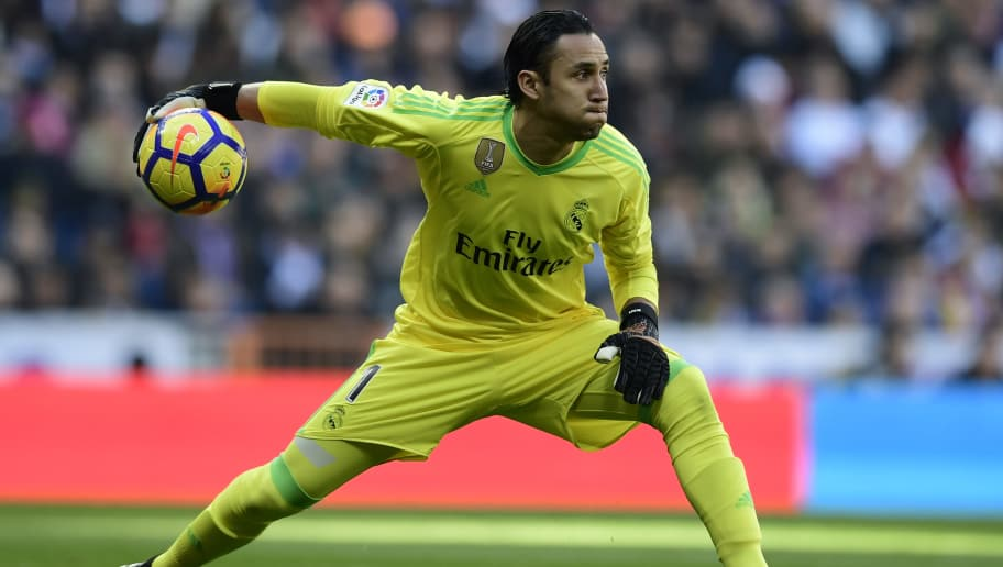 Real Madrid's Costa Rican goalkeeper Keylor Navas grabs the ball during the Spanish League 'Clasico' football match Real Madrid CF vs FC Barcelona at the Santiago Bernabeu stadium in Madrid on December 23, 2017.  / AFP PHOTO / JAVIER SORIANO        (Photo credit should read JAVIER SORIANO/AFP/Getty Images)