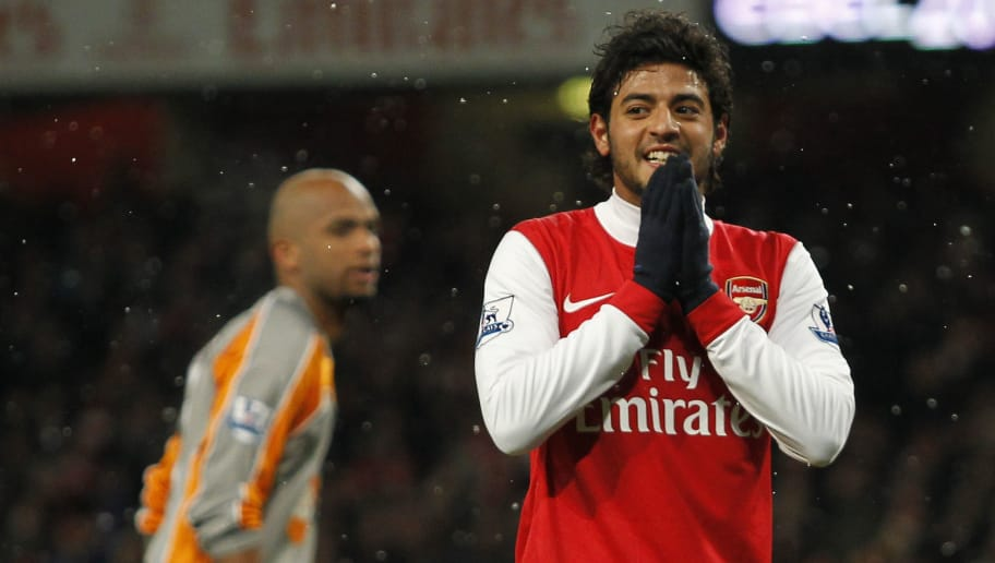 Arsenal's Carlos Vela gestures after seeing his shot at goal go wide against Wigan Athletic during the League Cup Quarter Final football match at The Emirates Stadium in London,  England on November 30, 2010. AFP PHOTO/IAN KINGTON  FOR EDITORIAL USE ONLY Additional licence required for any commercial/promotional use or use on TV or internet (except identical online version of newspaper) of Premier League/Football League photos. Tel DataCo +44 207 2981656. Do not alter/modify photo. (Photo credit should read IAN KINGTON/AFP/Getty Images)