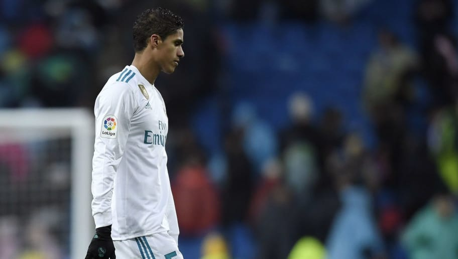 Real Madrid's French defender Raphael Varane reacts at the end of the Spanish league football match between Real Madrid and Villarreal at the Santiago Bernabeu Stadium in Madrid on January 13, 2018. / AFP PHOTO / GABRIEL BOUYS        (Photo credit should read GABRIEL BOUYS/AFP/Getty Images)
