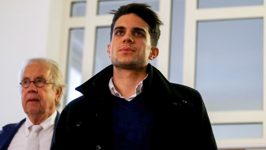 Borussia Dortmund's Spanish defender Marc Bartra arrives to testify in the trial of Sergej W., a man suspected of detonating three bombs targeting the Borussia Dortmund football team bus, at a German state court in Dortmund, western Germany, on January 29, 2018.  The blasts shattered bus windows and Spanish international Marc Bartra broke his wrist, while a motorcycle police officer suffered inner ear damage from the blast. The suspect had taken out options on thousands of Borussia's listed shares in advance and allegedly planned to sell them at a pre-determined level after the attack when he bet that share prices would plunge.  / AFP PHOTO / POOL / LEON KUEGELER        (Photo credit should read LEON KUEGELER/AFP/Getty Images)