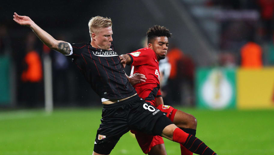 LEVERKUSEN, GERMANY - OCTOBER 24:  Benjamin Henrichs of Bayer 04 Leverkusen battles for the ball with Kristian Pedersen of FC Union Berlin during the DFB Cup match between Bayer Leverkusen and 1. FC Union Berlin at BayArena on October 24, 2017 in Leverkusen, Germany.  (Photo by Dean Mouhtaropoulos/Bongarts/Getty Images)