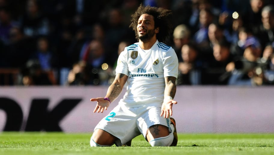 MADRID, SPAIN - DECEMBER 23:  Marcelo of Real Madrid reacts during the La Liga match between Real Madrid and Barcelona at Estadio Santiago Bernabeu on December 23, 2017 in Madrid, Spain.  (Photo by Denis Doyle/Getty Images)