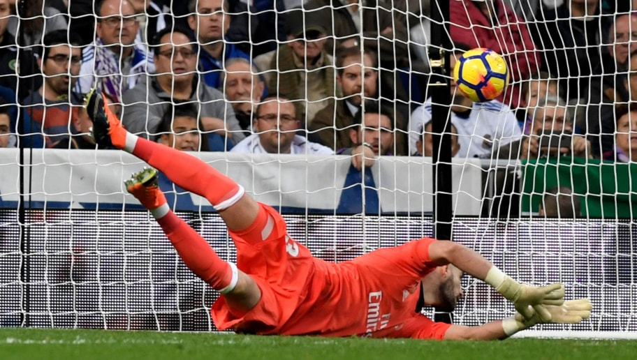 Real Madrid's Spanish goalkeeper Kiko Casilla fails to stop the ball kicked by Malaga's Uruguayan midfielder Chory Castro during the Spanish league football match Real Madrid CF against Malaga CF on 25, November 2017 at the Santiago Bernabeu stadium in Madrid. / AFP PHOTO / GABRIEL BOUYS        (Photo credit should read GABRIEL BOUYS/AFP/Getty Images)