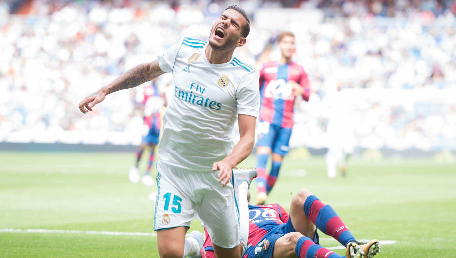MADRID, SPAIN - SEPTEMBER 09: Theo Hernandez of Real Madrid CF is tackled by Pedro Lopez of Levante UD during the La Liga match between Real Madrid and Levante at Estadio Santiago Bernabeu on September 9, 2017 in Madrid, . (Photo by Denis Doyle/Getty Images)