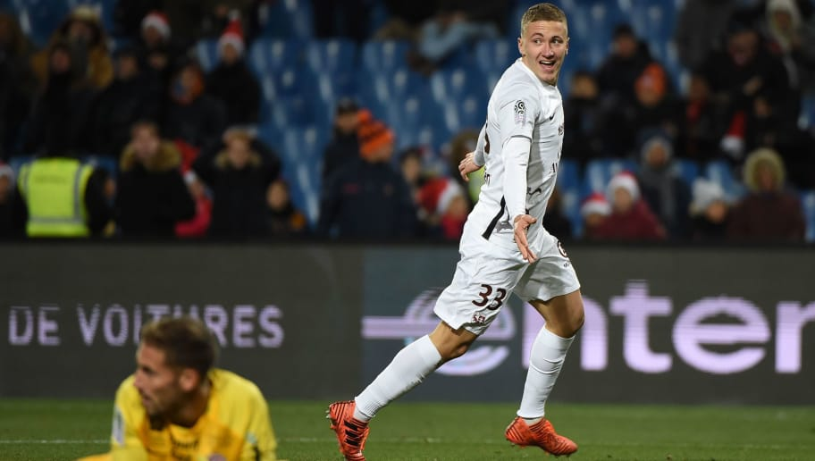 Metz' French defender Nicolas Basin (R) celebrates after scoring a goal during the French L1 football match between Montpellier and Metz, on December 16, 2017 at the La Mosson Stadium in Montpellier, southern France. / AFP PHOTO / SYLVAIN THOMAS        (Photo credit should read SYLVAIN THOMAS/AFP/Getty Images)