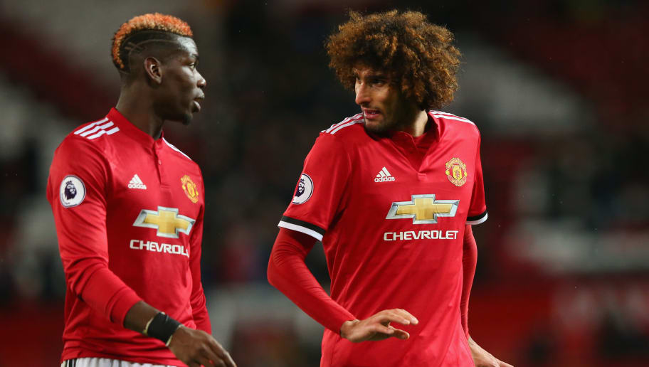MANCHESTER, ENGLAND - NOVEMBER 25:  Paul Pogba and Marouane Fellaini of Manchester United speak following the Premier League match between Manchester United and Brighton and Hove Albion at Old Trafford on November 25, 2017 in Manchester, England.  (Photo by Alex Livesey/Getty Images)