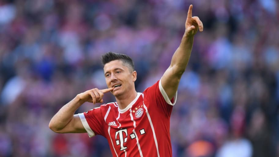 Bayern Munich's Polish striker Robert Lewandowski celebrates his scoring 4:0 during the German First division Bundesliga football match FC Bayern Munich vs SC Freiburg in Munich, southern Germany, on October 14, 2017. / AFP PHOTO / Christof STACHE / RESTRICTIONS: DURING MATCH TIME: DFL RULES TO LIMIT THE ONLINE USAGE TO 15 PICTURES PER MATCH AND FORBID IMAGE SEQUENCES TO SIMULATE VIDEO. == RESTRICTED TO EDITORIAL USE == FOR FURTHER QUERIES PLEASE CONTACT DFL DIRECTLY AT + 49 69 650050         (Photo credit should read CHRISTOF STACHE/AFP/Getty Images)