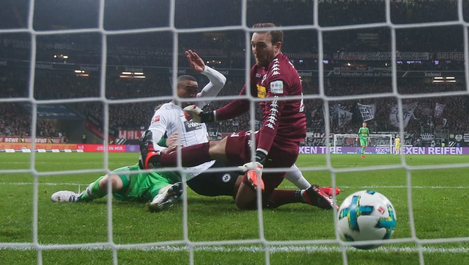 FRANKFURT AM MAIN, GERMANY - JANUARY 26:  Kevin-Prince Boateng of Frankfurt scores his team's first goal against goalkeeper Tobias Sippel of Moenchengladbach during the Bundesliga match between Eintracht Frankfurt and Borussia Moenchengladbach at Commerzbank-Arena on January 26, 2018 in Frankfurt am Main, Germany.  (Photo by Alex Grimm/Bongarts/Getty Images)